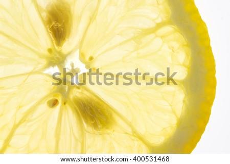 Slice of fresh lemon isolated on white background - stock photo