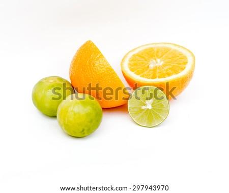 Slice of fresh orange and Slice of fresh lime on white background.Healthy citrus fruity food. - stock photo