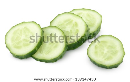 Slice of green cucumber vegetable isolated on white with clipping path - stock photo