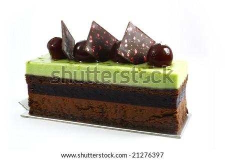 slice of green tea chocolate cake on white background - stock photo