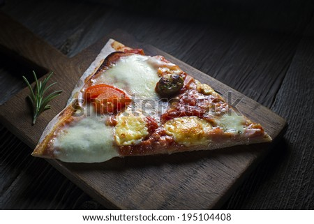 Slice of home made pizza close up shoot - stock photo