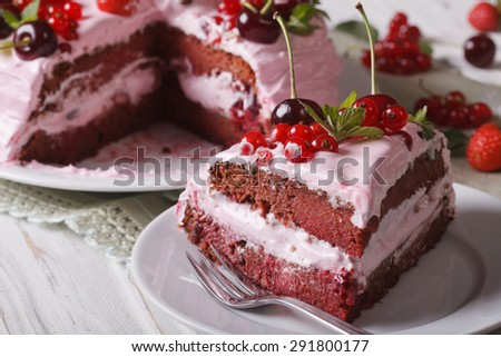 Slice of homemade berry cake with pink cream on a plate close-up. horizontal
