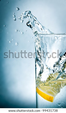 slice of lemon drops in a glass of water - stock photo