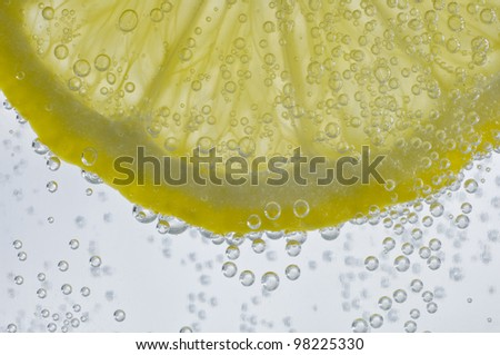 Slice of lemon in fizzy drink- with bubbles