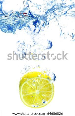 slice of lemon in water isolated light grey - stock photo