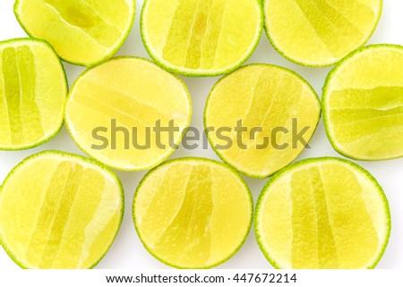 Slice of lemon on white background - stock photo