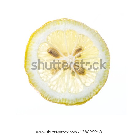 Slice of Lemon with pips, isolated on white with clipping path