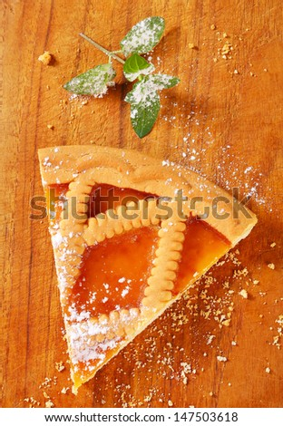 Slice of Linzer apricot tart - stock photo