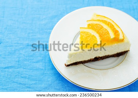 slice of new York cheesecake decorated with oranges. toning. selective focus - stock photo