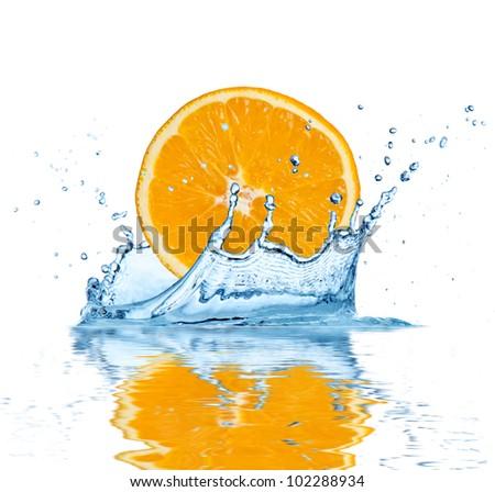 Slice of orange falling into water, isolated on white background - stock photo
