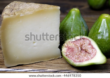 Slice of pecorino cheese with green figs in season - stock photo