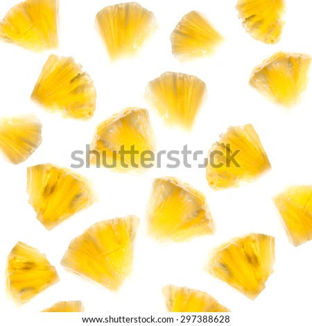 Slice of pineapple flow in the air with lighting from behind. - stock photo