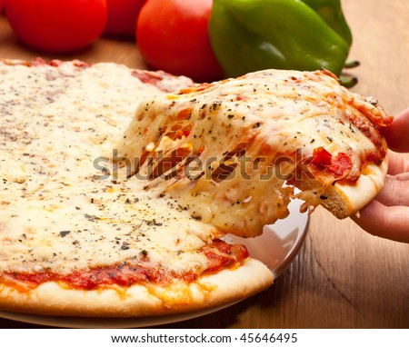 Slice of pizza margarita lifted up - stock photo