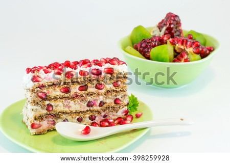 slice of pomegranate cake in a green plate