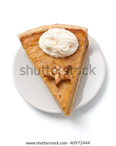 slice of pumpkin pie with whipped cream on a plate - stock photo