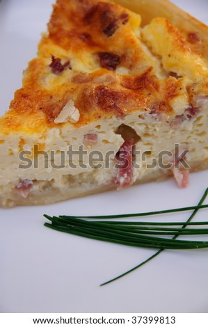 Slice of quiche on a plate - stock photo