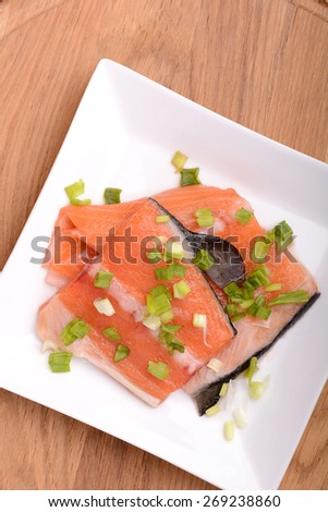 Slice of red fish salmon on wooden plate  - stock photo