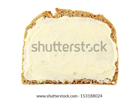 Slice of rye bread with butter isolated on white