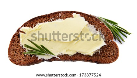Slice of rye bread with butter, isolated on white - stock photo
