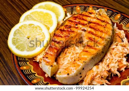 Slice of salmon on carrot salad - stock photo