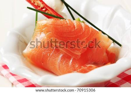 Slice of smoked salmon and baby mozzarella - stock photo
