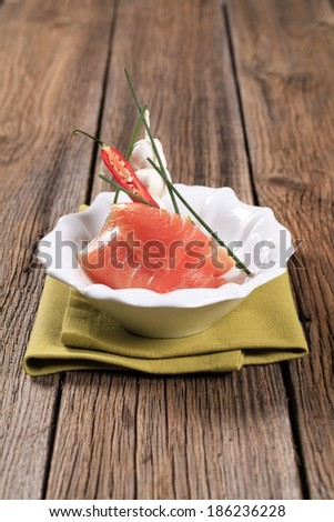 Slice of smoked salmon, mozzarella cheese and kiwi - stock photo