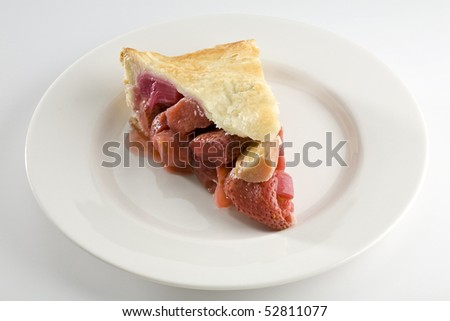 Slice of strawberry and rhubarb pie on white plate - stock photo