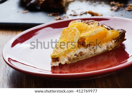 Slice of tart with cottage cheese and sliced orange