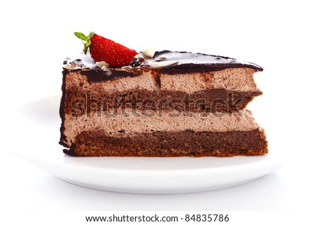 Slice of tasty chocolate cake with strawberry on top against white background - stock photo