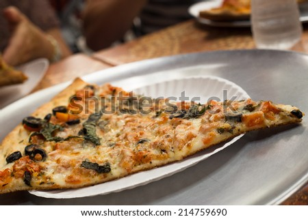 Slice of traditional New York Style pizza - stock photo