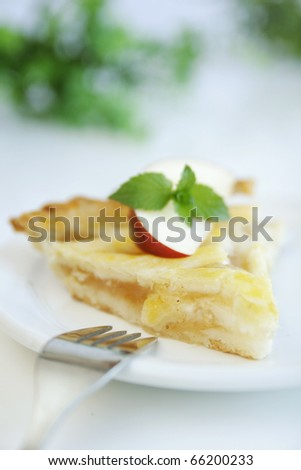 Slice of warm apple pie with fork - stock photo