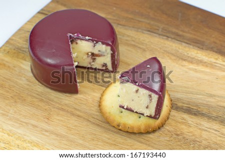 Slice of Wensleydale and Cranberry on cracker  - stock photo
