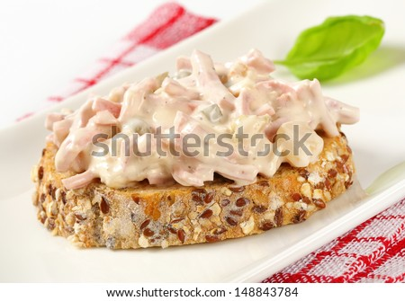 Slice of whole wheat bread with mayonnaise salad on a plate - stock photo