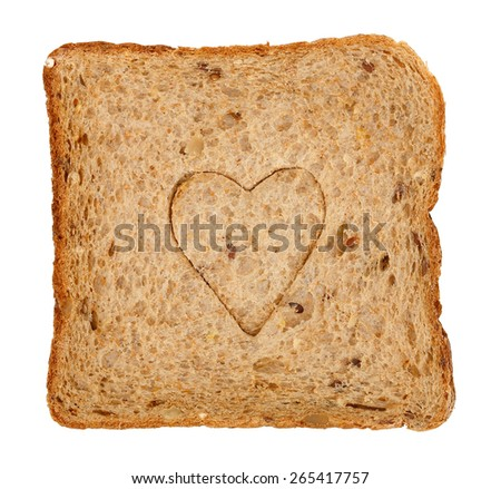 slice of whole wheat toast bread with heart shape isolated on white