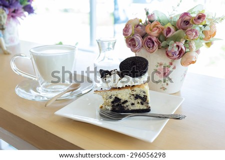 slice piece of cake with chocolate cookie