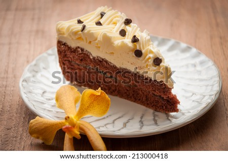 Slice piece of vanilla cake topping with white chocolate chips for coffee or tea break, an image isolated on white - stock photo
