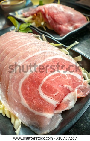 Slice Pork on black dish