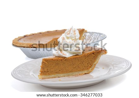 slice pumpkin pie on plate isolated on white background