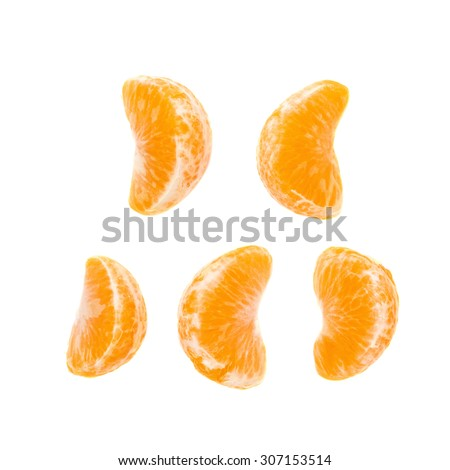 Slice sections of ripe tangerine isolated over the white background - stock photo