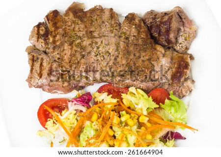 slice tenderloin with salad. Closeup - stock photo