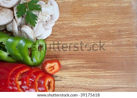 Slice veggies on wooden board with empty space for text - stock photo