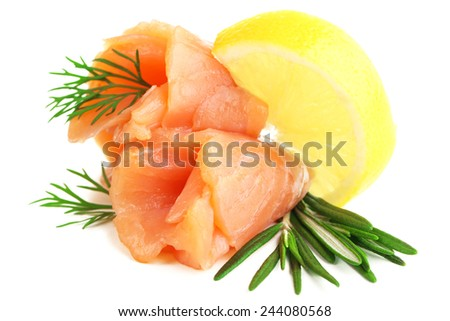 Sliced and rolled salmon  with lemon slice on salad leaf  isolated on white - stock photo