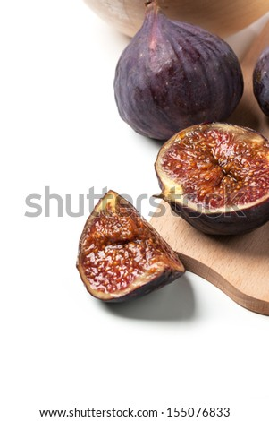 Sliced and whole figs over white