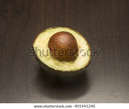 Sliced Avocado and seed/Avocado/Freshly cut avocado ready for eating - stock photo