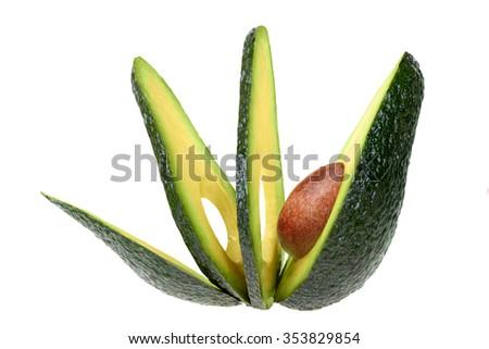 sliced avocado isolated on white background - stock photo