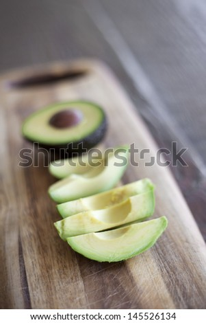 Sliced Avocado on a cutting board - stock photo