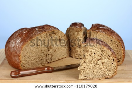 sliced bread on blue background close-up