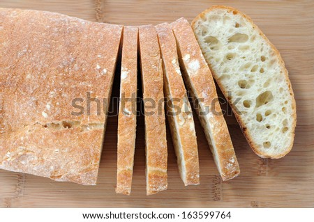 sliced bread on cutting board - stock photo