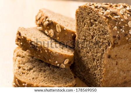 sliced ??bread with cereals is on the board - stock photo