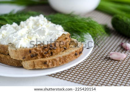 Sliced bread with cream cheese - stock photo